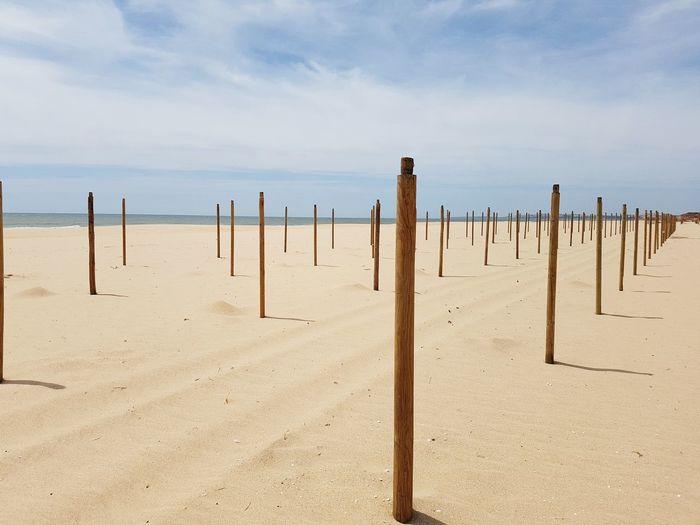 Beach to myself Vilamoura Algarve Beach Wooden Post Sea Sand Arid Climate Wood - Material Desert Sky Horizon Over Water Landscape Sand Dune