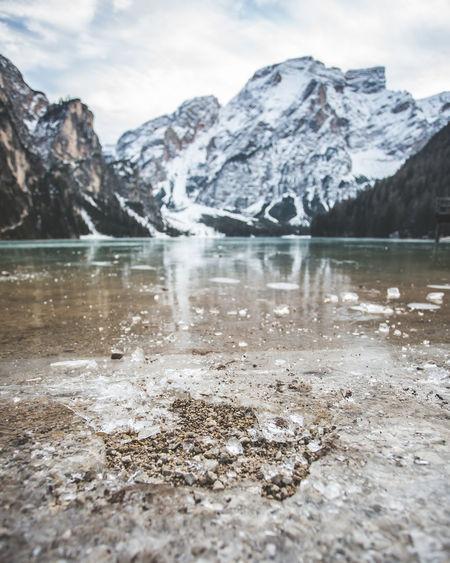 Surface level of frozen lake against mountain range