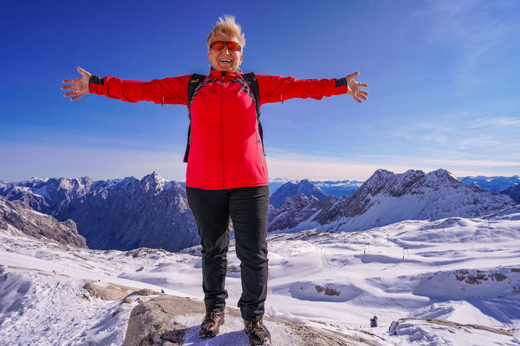 Full length of person standing on snow covered mountain