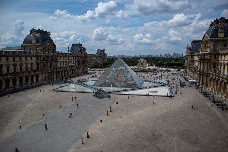 Louvre Ancient Civilization Architecture Building Building Exterior Built Structure City Cloud - Sky Day History Incidental People Nature Old Place Of Worship Religion Sky The Past Tourism Travel Travel Destinations