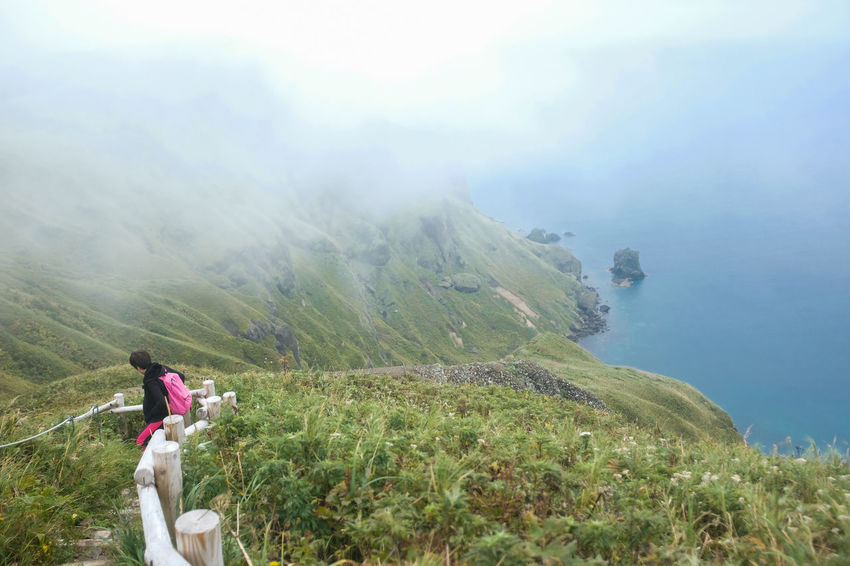 Rebun Island Hokkaido Mountain One Person Leisure Activity Adventure Activity Scenics - Nature Nature Beauty In Nature Day Fog Hiking Adult Environment Rear View Plant Women Sky Non-urban Scene Vacations Mountain Range Outdoors Looking At View