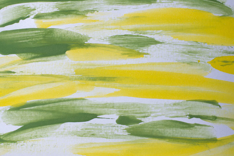 Close-up of yellow painted paper