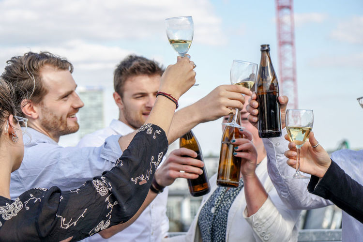 Alcohol Body Part Business Events Celebration Celebratory Toast Drink Drinking Food And Drink Friendship Glass Group Of People Happiness Holding Men Refreshment Smile Smiling Social Event  Success Togetherness Wine Young Adult Young Men