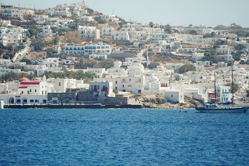 Mykonos town seen from ferry Greek Islands Mykonos Town Mykonos,Greece Architecture Building Exterior Built Structure City Cityscape Cyclades Day Greece Mykonos Mykonostown Nature No People Outdoors Sea Water Waterfront