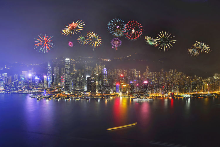 Night view and fireworks at victoria harbour, Hong Kong Celebration Celebration Chinese New Year Christmas Cityscape Event Exploding Firework - Man Made Object Firework Display Happy Harbour Holiday - Event Hong Kong Multi Colored New Year Night No People Outdoors Reflection Sky Victoria Water