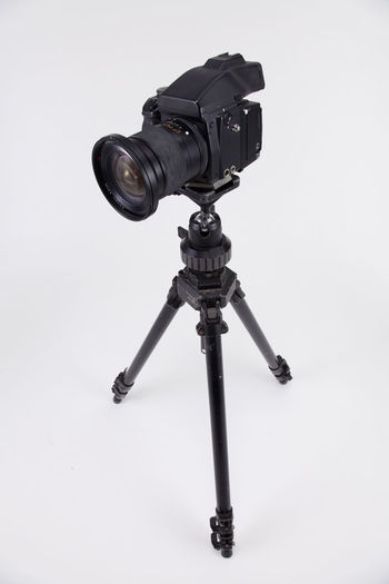 studio shot of high end digital camera on the tripod Camera Photography Multimedia Expertise Professional Occupation Tripod Photograph DSLR Lens Equipment Photographic Theme Photographing Black Nobody White Background SLR Camera Photography Themes Technology Studio Shot Camera - Photographic Equipment Indoors  No People Still Life Photographic Equipment Close-up Digital Camera Copy Space Single Object High End Medium Format Black Color