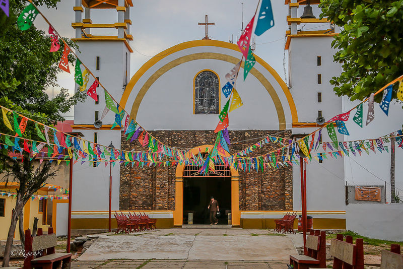 iglesia chiapaneca Architecture Building Exterior Built Structure Day Hanging Multi Colored One Person Outdoors Place Of Worship Real People Religion Sky Spirituality Tree The Photojournalist - 2017 EyeEm Awards