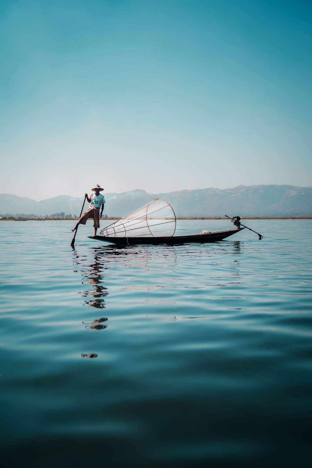 water, nautical vessel, one person, waterfront, transportation