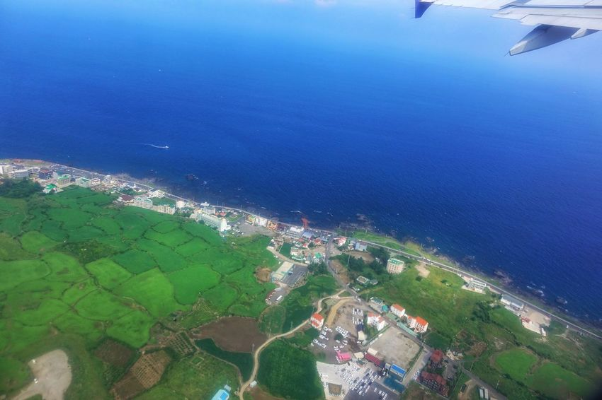 Korea Photos Aerial View Sea Urban Skyline High Angle View Beach Nature Vacations Landscape Scenics Outdoors Blue Flying Sky Airplane Rural Scene Water Travel Beauty In Nature No People Architecture Island Jeju JEJU ISLAND  Streamzoofamily
