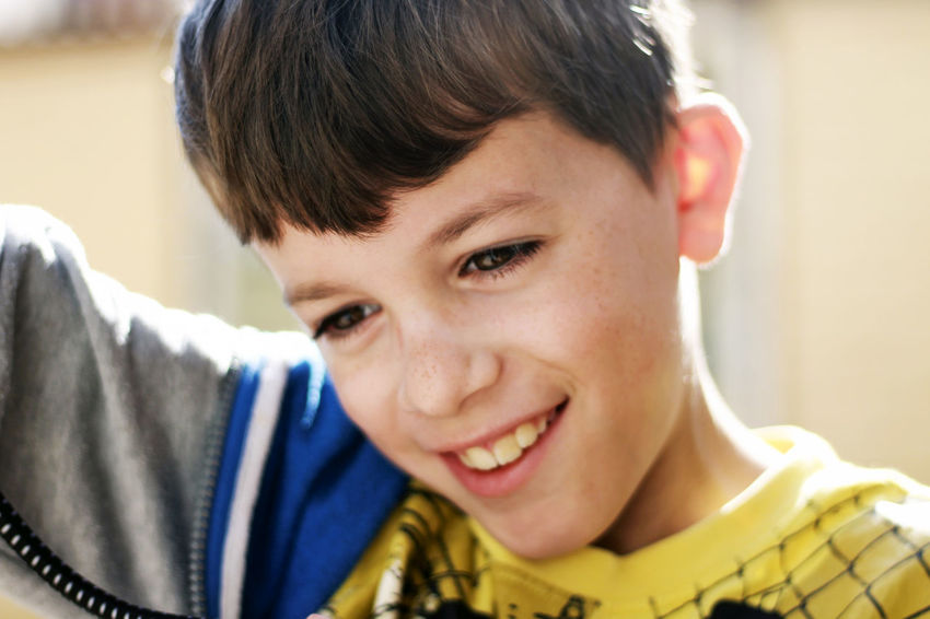 Portrait of a boy smiling. Young Youth Boys Child Childhood Close-up Emotion Focus On Foreground Front View Happiness Headshot Innocence Leisure Activity Lifestyles Male Males  One Person Portrait Real People Smile Smiling Sun