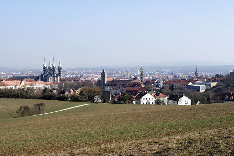Bamberg with a view from above Built Structure Architecture Building Exterior Sky Building City Landscape Field Nature Plant Land Residential District Day Clear Sky Outdoors Tree Cityscape Grass Bamberg  Bayern Germany Bayern