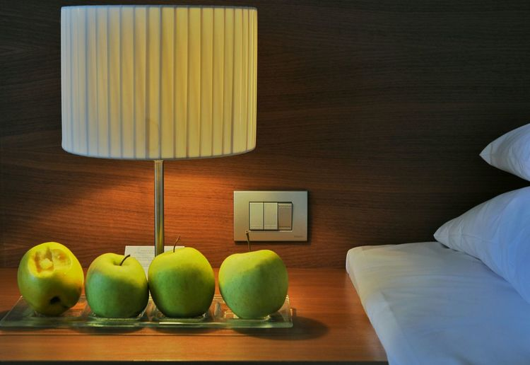 Green Apples On A Nightstand