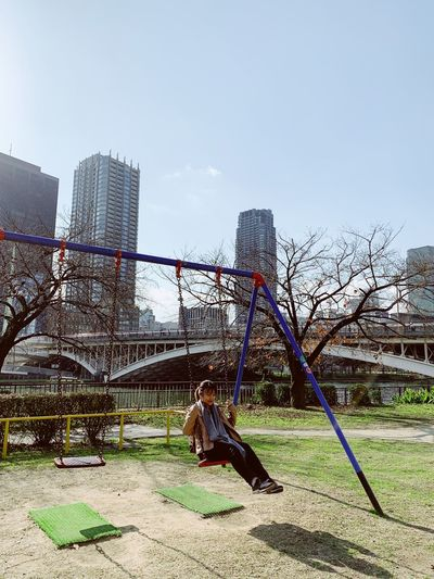 When was the last time you ever sat on a swing OSAKA Osaka,Japan Japan Travel Destinations Sky Nature Architecture Built Structure Fence Building Exterior Moments Of Happiness Day Park Playground Park - Man Made Space