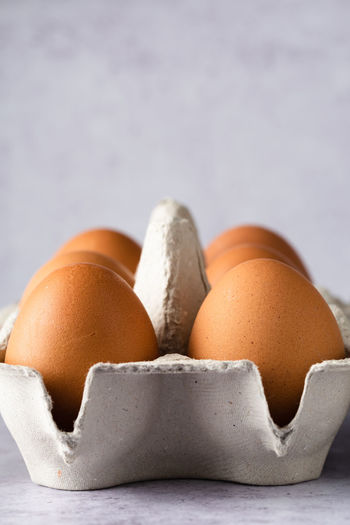 eggs in carton   food photography Food Food And Drink Egg Freshness No People Close-up Egg Carton Healthy Eating Still Life Group Of Objects Raw Food Focus On Foreground Medium Group Of Objects Food Photography Foodphotography negative space Light And Shadow