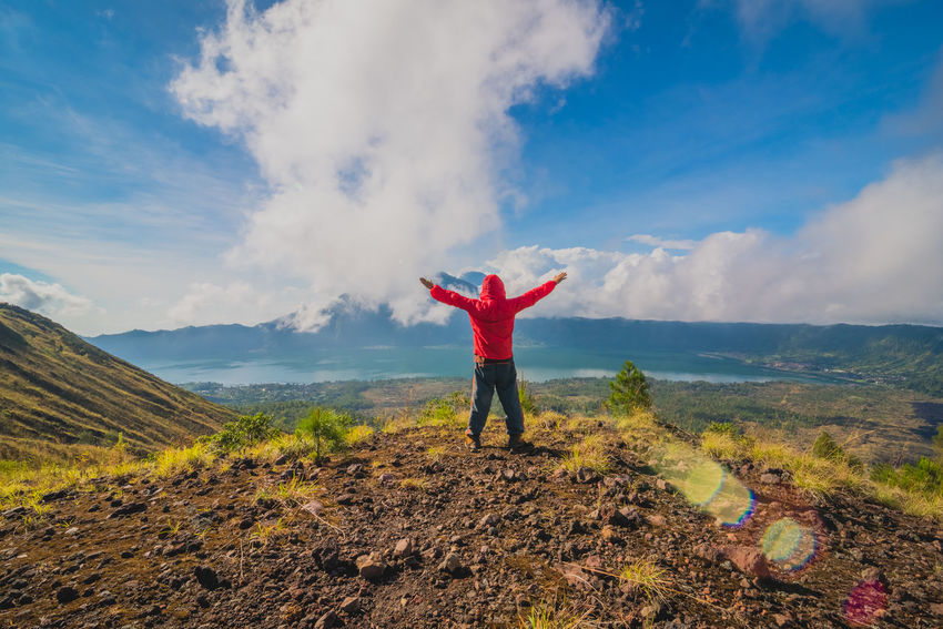 Young man standing with raised hands on top of a mountain and enjoying valley view Bali Bali, Indonesia Batur Freedom Hiking Nature Tourist Vacations Arms Outstretched Arms Raised Batur Mountain View Beauty In Nature Cloud - Sky Day Full Length Hand Raised Happiness Hiker Human Body Part Human Hand Lake Leisure Activity Lifestyles Mountain Nature One Person Outdoors People Real People Sky Standing Tourism Volcano
