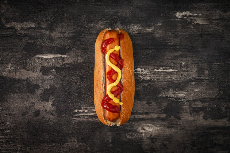 Directly above shot of hot dog on rustic table