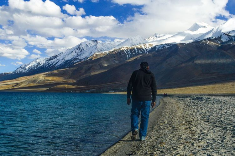 Follow the path to your Personal Legend. Pangong Lake, Ladakh, India. Mountain Rear View Mountain Range Cloud - Sky One Man Only Beauty In Nature One Person Only Men Scenics Sky Nature Landscape Lake Standing Adults Only Outdoors Full Length Snow Day People