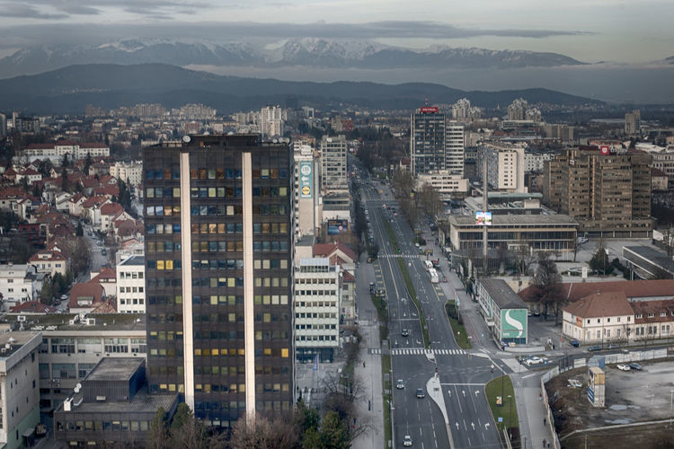 Building Exterior City Architecture Built Structure Cityscape Building Residential District Mountain High Angle View Transportation Outdoors Nature Crowded Sky Crowd City Life Cloud - Sky Day Street Mode Of Transportation Modern Office Building Exterior Skyscraper Ljubljana Slovenia