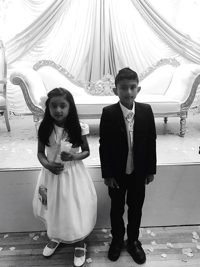 Two People Looking At Camera Full Length Real People Girls Elementary Age Childhood Portrait Lifestyles Front View Bonding Togetherness Standing Smiling Cheerful Indoors  Day Life Events Wedding Dress Adam Miah Amelia Miah Brother & Sister