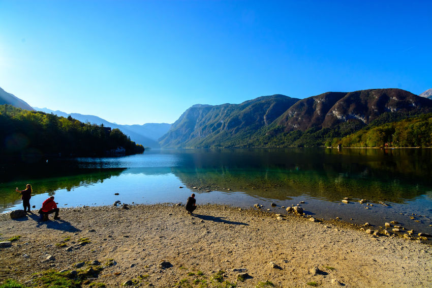 Nature Sky Day Bohinjsko Jezero Water Mountain Lake Scenics - Nature Clear Sky Beauty In Nature Tranquil Scene Mountain Range Tranquility Real People Reflection Non-urban Scene People Leisure Activity Men Blue Outdoors