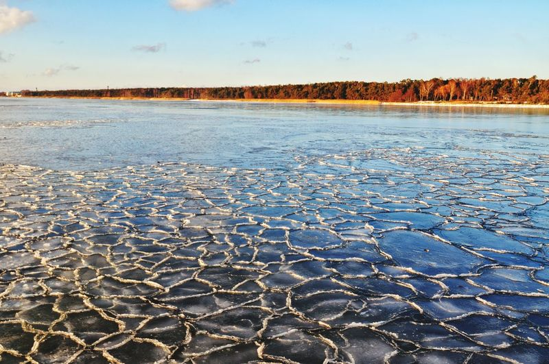 Winter landscape - frozen sea in jurata, hel peninsula, poland Frozen Frost Frosty Ice Cold Winter Poland Sea Baltic Sea Scene EyeEm Selects Outdoors Cracked Landscape Day No People Nature Sunset Beauty In Nature Blue Sky Water Shades Of Winter