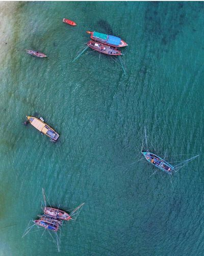 Directly above view of fishing boats in sea