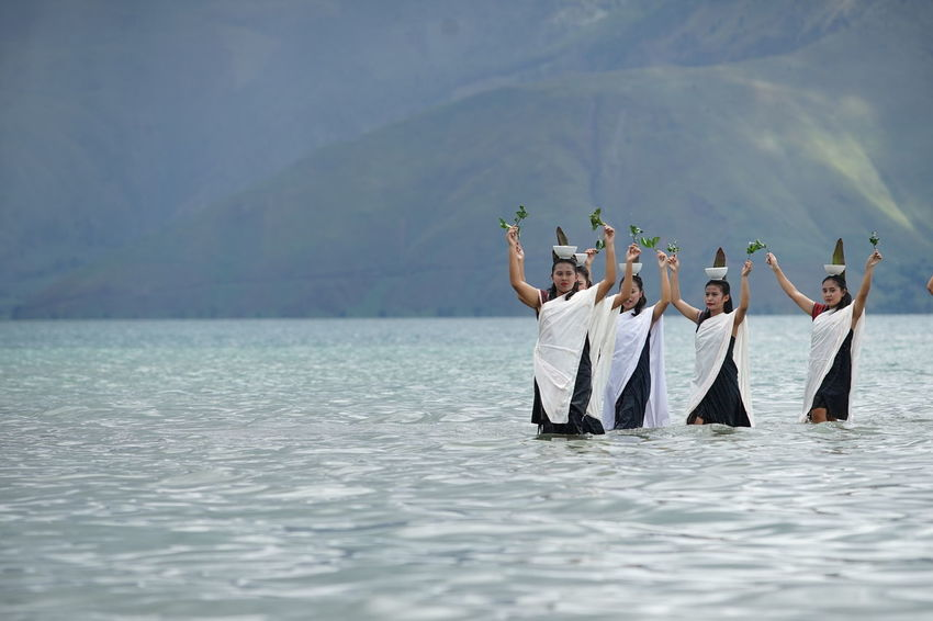 Lake Toba Dance Adult Arms Raised Beauty In Nature Day Friendship Group Of People Human Arm Leisure Activity Lifestyles Men Mountain Nature Outdoors People Real People Sea Togetherness Water Waterfront Women