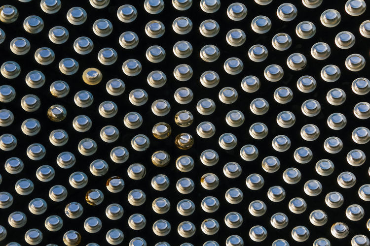 Backgrounds Full Frame Pattern Geometric Shape Shape Circle Repetition Indoors  No People Lighting Equipment Illuminated In A Row Abundance Close-up Side By Side Design Large Group Of Objects Technology Low Angle View Grid Ceiling Directly Below