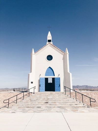 Desert Architecture Belief Blue Building Building Exterior Built Structure Clear Sky Day Nature No People Outdoors Place Of Worship Religion Sky Spire  Spirituality Sunlight Tower