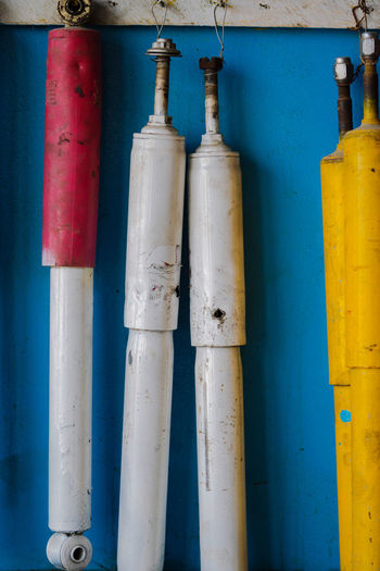 Close-up of pipes against blue wall