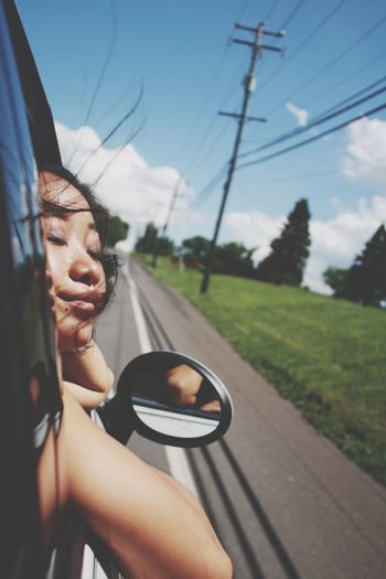 Woman With Eyes Closed Traveling In Car