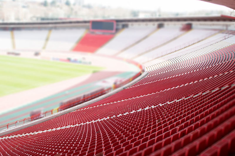 red seats at the stadium Sport Red Close-up No People Day Stadium Sports Track In A Row Competition Seats Plastic Background Objects Outdoors Soccer Field Detail Game Architecture Public Empty Bench Arena Levels Modern