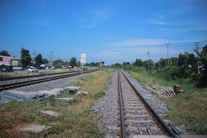 Railway tracks against blue sky
