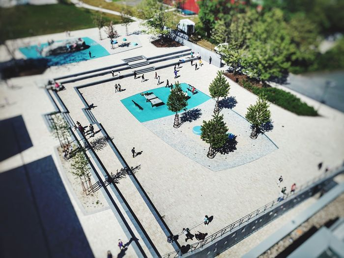 High angle view of swimming pool by trees in city