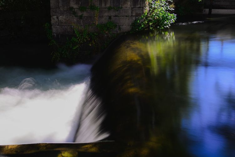 Blurred motion of waterfall by lake