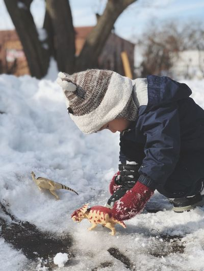 Boy Playing With Toys On Snow