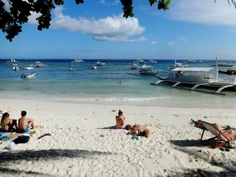 Paliton Beach Philippines Sea Beach Water Tourist In The Beach Summer Vacation Summer Sunbathing Vacations Scuba Diving Nautical Vessel Beauty In Nature Cloud - Sky White Sand Beach Tourist Spots Resort Vacation Getaway Travel Destinations Traveler's Lifestyle