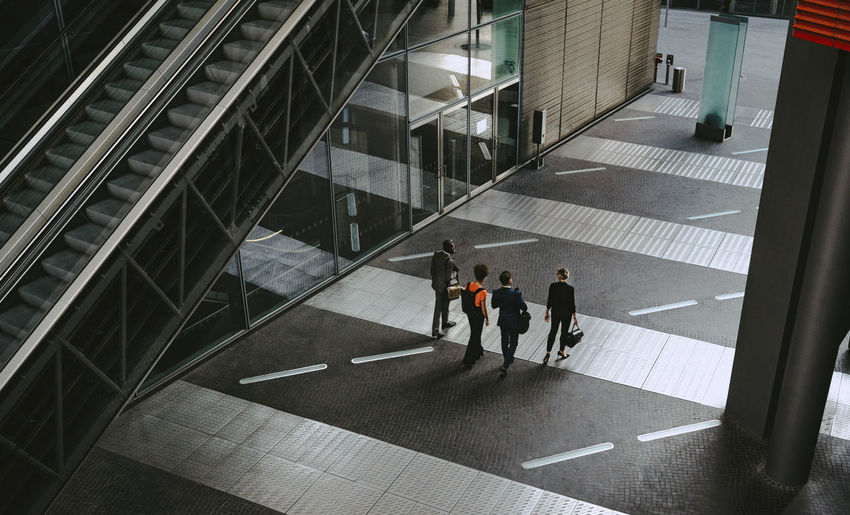 High angle view of people walking on modern building
