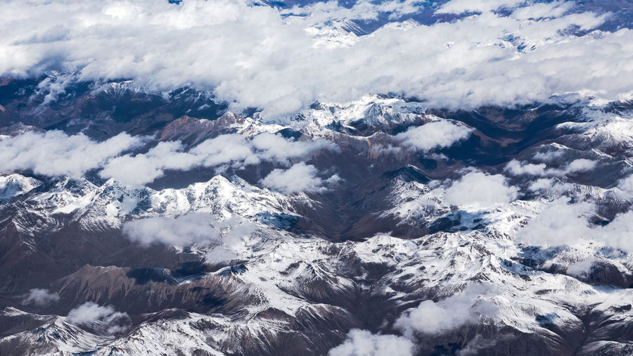 Flyover snow mountains Perspectives On Nature Beauty In Nature Cloud - Sky Cold Temperature Day Landscape Nature No People Outdoors Scenics Sky Tranquil Scene Tranquility