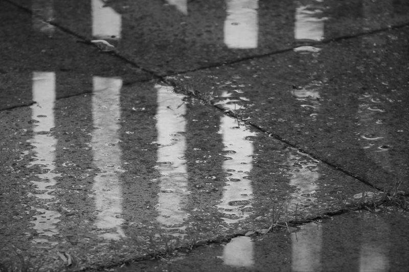 Englands greatest topic! The Weather!! Wet n orrible!! Searching for the light amongst the gloom :-) Abandoned Bad Condition Cancelled Destruction Deterioration Full Frame Gate Gateway High Angle View Low Section One Person Outdoors Pavement Puddle Rain Rainy Day Rainy Days Reflection Reflection_collection Shadow Sidewalk Textured  Water Reflections Weather Wet