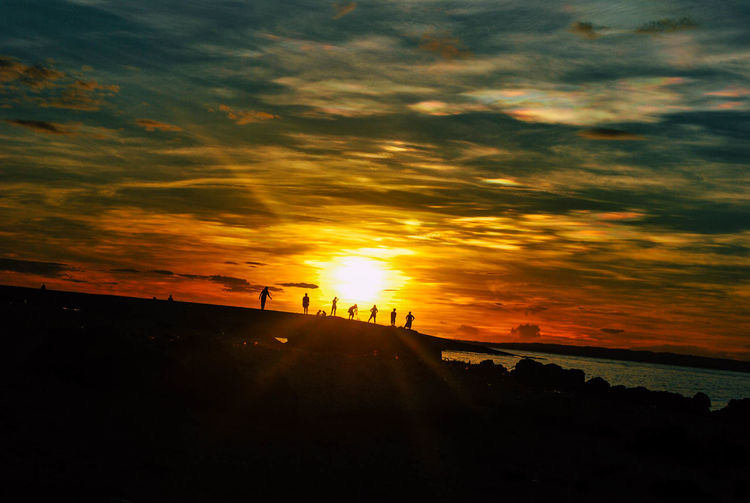 Friends at the sun Sunset Dramatic Sky Silhouette Nature Vacations People Beauty In Nature Neverstopexploring  Lifeofadventure Wanderlust Outdoors Explore The World