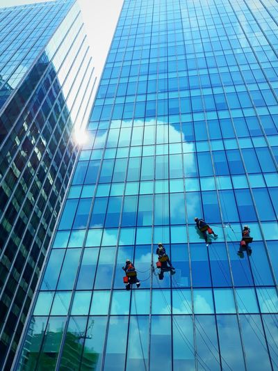 Low angle view of workers on modern office building