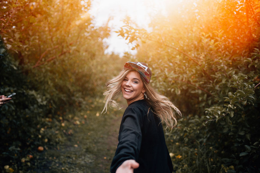 young woman beckoning to you to follow her on an adventure during sunset Apparel Apparel Industry Clothing Brand Clothing Line Clothing Store Friendship Friendship. ♡   Girl Power Golden Hour Influencer Instagramers Lifestyle Photography Nature Outdoors Sunset Travel Photography Traveling Woman Portrait Women Power Women Who Inspire You Womens Rights Womensfashion Young Adult
