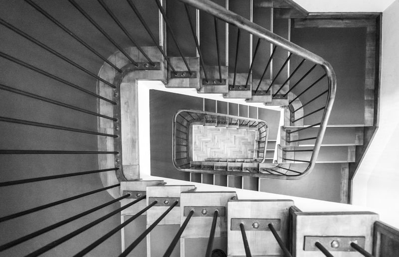 Black And White Architecture Best Of Stairways Railing Staircase Steps And Staircases Spiral Staircase Spiral Indoors  Built Structure No People Directly Above Absence Design High Angle View Repetition Empty Diminishing Perspective Day Shape Pattern