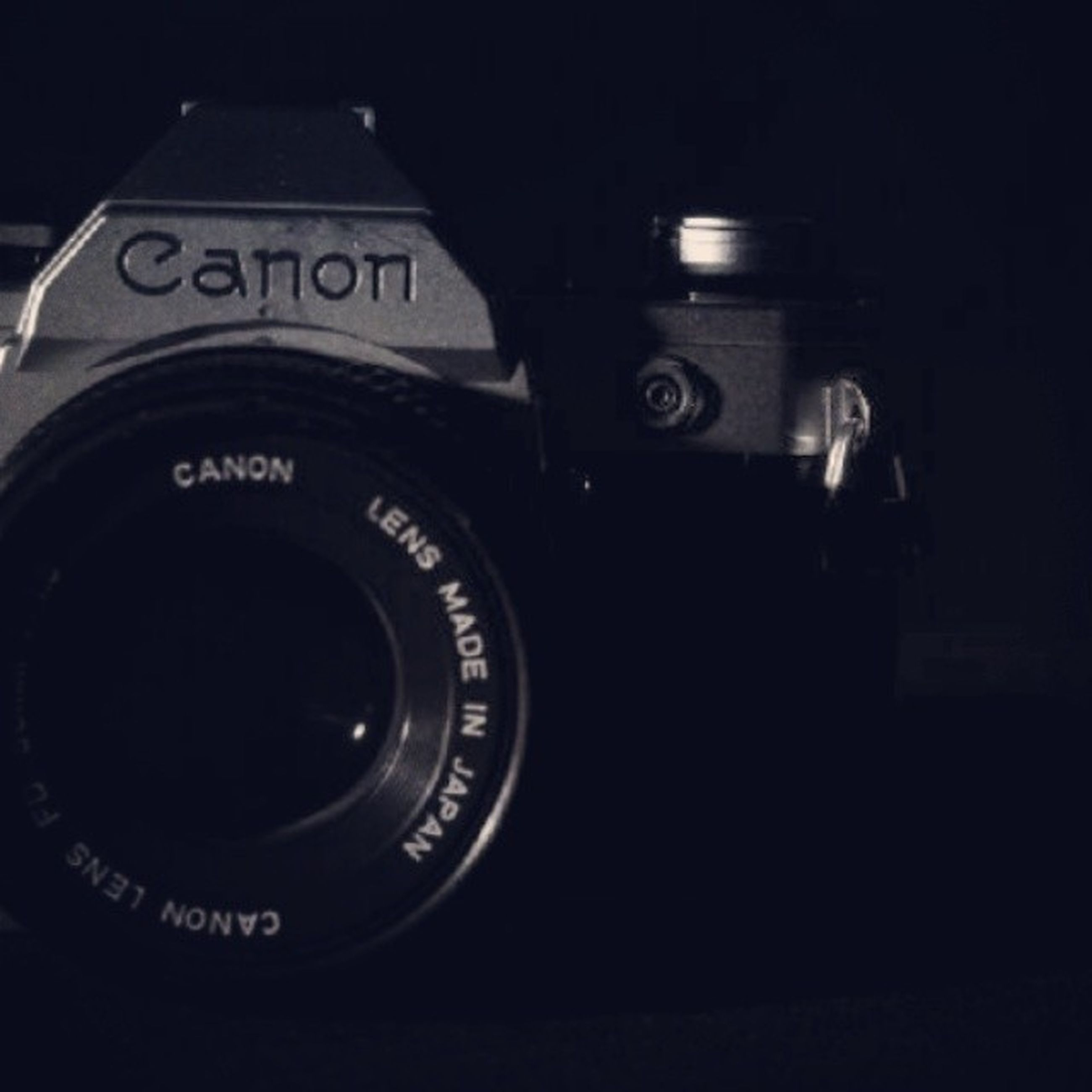 technology, communication, photography themes, indoors, camera - photographic equipment, close-up, wireless technology, text, retro styled, number, photographing, old-fashioned, lens - optical instrument, western script, digital camera, time, connection, mobile phone, telephone, smart phone