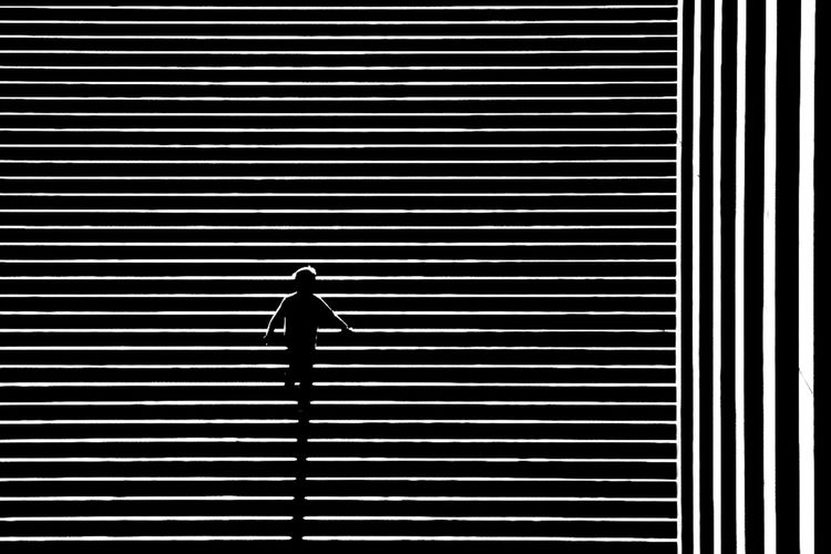 Life Lines Black & White Lines Nikon Paris Street Light Black And White Photography Blackandwhite Bnw Chadow Child Day Full Length Lifestyles One Person Outdoors Pattern People Real People Silhouette Street Street Photography Streetphoto_bw Streetphotography The Street Photographer - 2018 EyeEm Awards The Creative - 2018 EyeEm Awards #urbanana: The Urban Playground