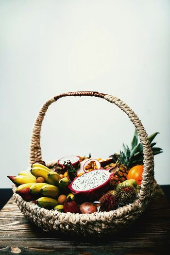 Fruits in basket on wood