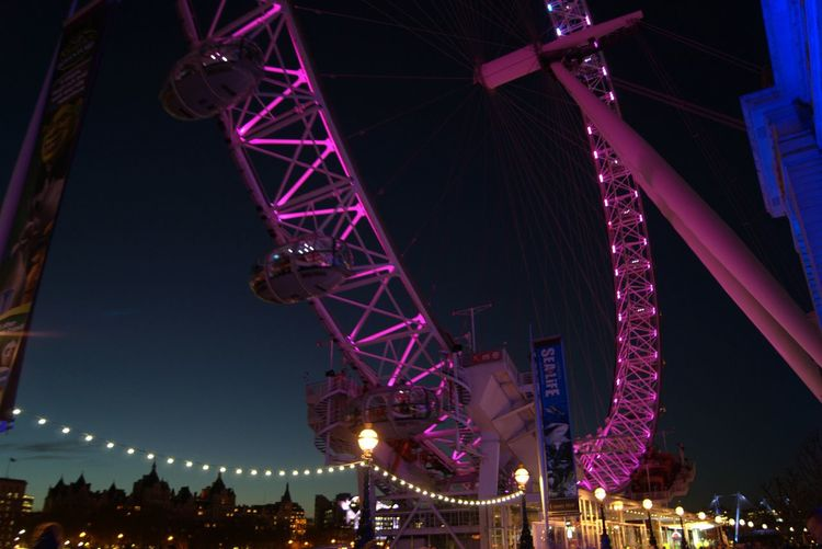 My Year My View Night Low Angle View City LondonEye Travel PhotographyAmusement Park Ride Pointofview Prospective Architecture Travel Destinations London Colorful Explorethecity Ferris Wheel Amusement Park Sky Illuminated Outdoors People