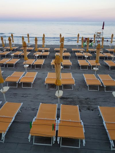 Beach Sea Sand Chair Outdoors Large Group Of People People Water Day Adult Adults Only Sky Nature Only Men In A Row Close-up Tranquility Travel Destinations Liguria, Italy Beach Umbrella Summer Vacations Group Of Objects Arrangement No People