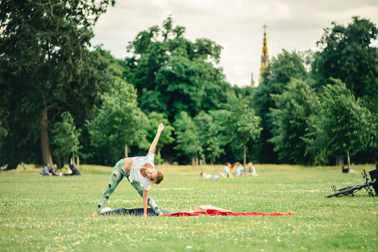 Be. Ready. Exercise Exercising Green Color In The Park Resolutions Yoga Yoga Pose Ardha Chandrasana Day Exercise Time Full Length Girl Doing Yoga Green Color Healthy Lifestyle One Person Outdoors People Trikonasana Love Yourself Modern Workplace Culture Inner Power Adventures In The City Going Remote